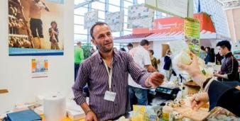Exhibitors on its Sicilian dairy products stand