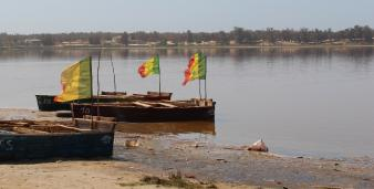 Senegal boat photo with the Senegalese flag flying in the wind