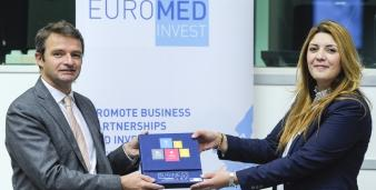 Emmanuel Noutary and Jihen Boutibaholding the EUROMED Invest Business Guide